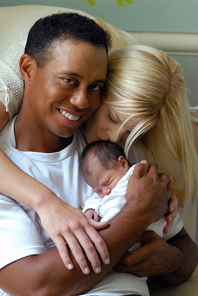 Tiger and Elin Woods with Sam Alexis