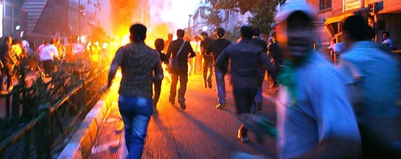 Supporters of defeated Iranian presidential candidate Mir Hossein Mousavi run in the streets during protests June 16, 2009 in Tehran, Iran.