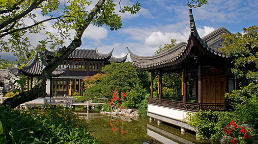 AMFX34 Two pavilions the Tea House sits across Zither Lake at the Portland Classical Chinese Garden Ming Dynasty style garden POR