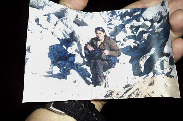 One of the most important things that the miners requested initially were  photographs of their loved ones.  Here, Peña holds a snapshot of his partner, Angelica Alvarez.