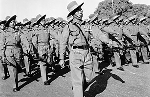 A troop of Nepalese Gurkhas marching in formation in India.