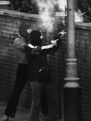 Members of the Special Air Service, hooded to avoid identification, fire tear gas at the Iranian embassy in London on May 5, 1980.