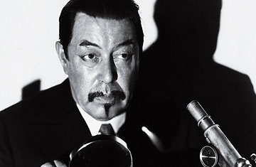 Charlie Chan Watching the Detective TIME