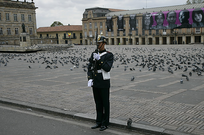 A member of the Colombian military honor guard stands in front of Plaza De Bolivar as President Bush's motorcade passes in Bogota, Colombia, March 11, 2007.