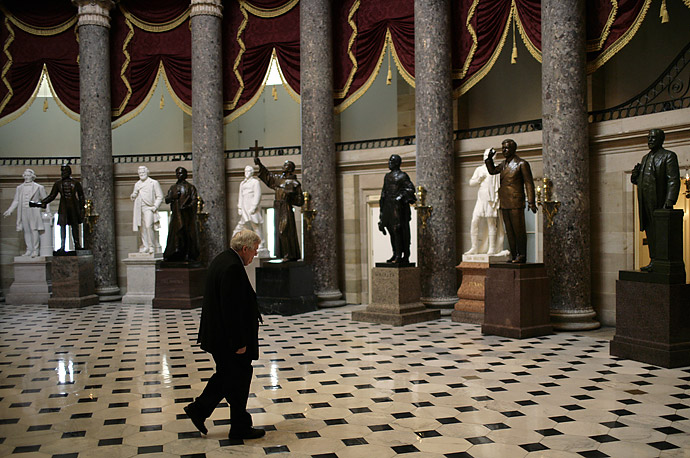 Former Speaker of the House Dennis Hastert walks through Statutory Hall while President Bush attends a luncheon with current Congressional leaders at the Capitol in Washington, D.C., March 15, 2007.