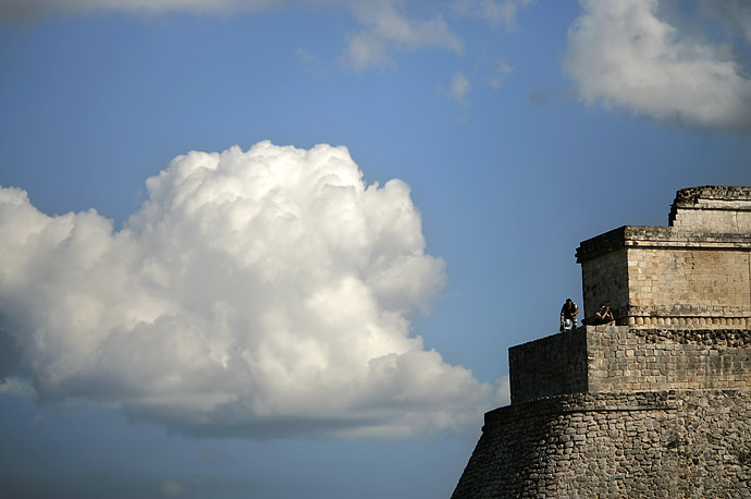Security officers watch from atop of The Magicians Pyramid while U.S. President Bush and Mexican President Felipe Calderon visit the ruins of the ancient Mayan city of Uxmal, Mexico,  March 13, 2007.