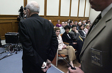 The jury watches convicted murderer Father Gerald Robinson leave the ...