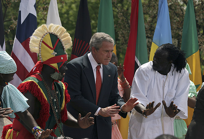 President Bush dances with the Kankouran West African Dance Company during a Malaria Awareness Day event in the Rose Garden of the White House