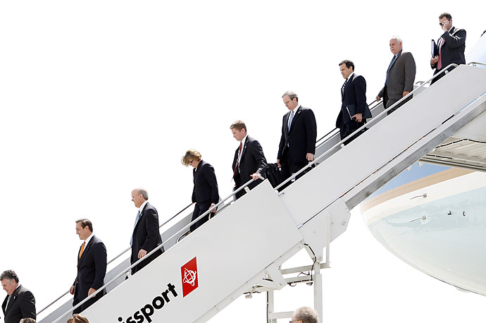 White House staff and aides to President Bush disembark from Air Force One in New York City.