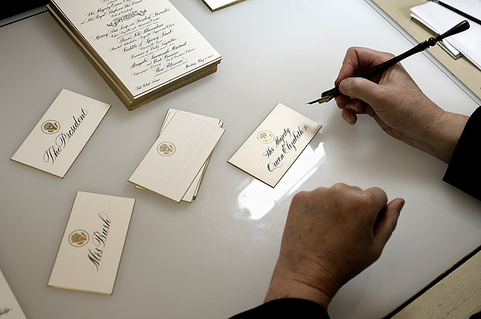 A White House calligrapher works on place cards and menus for a State Dinner in honor of the Queen Elizabeth II, May 7, 2007.