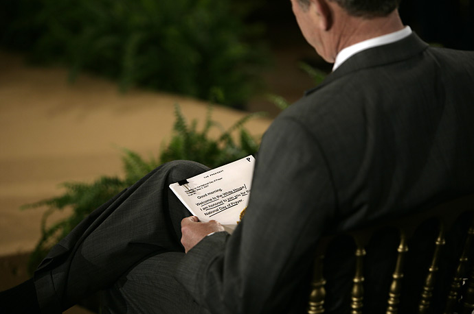 President George W. Bush looks over his notes before speaking at a National Day of Prayer ceremony in the East Room at the White House, May 3, 2006 .