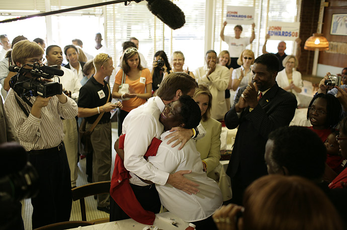 Democratic presidential candidate John Edwards gets a hug as he stops to campaign at Kitty's Soul Food in Charleston, SC, July 24, 2007.