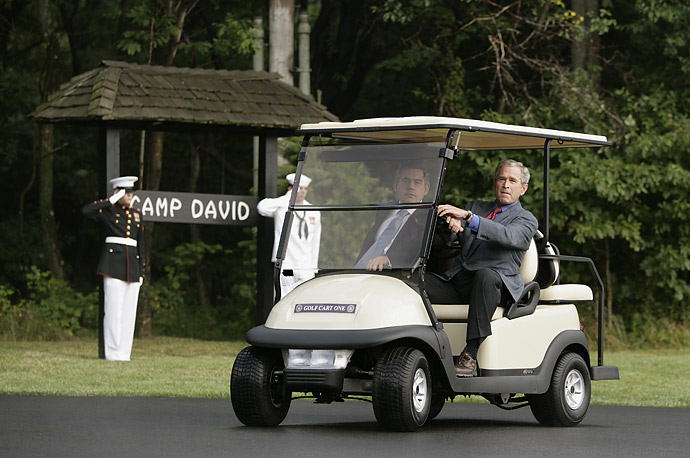 President George W. Bush gives a ride to British Prime Minister Gordon Brown in