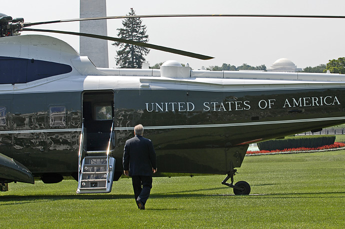 Deputy White House Chief of Staff Karl Rove heads toward Marine One on the south lawn of the White House after announcing his plans to leave his post at the end of August.