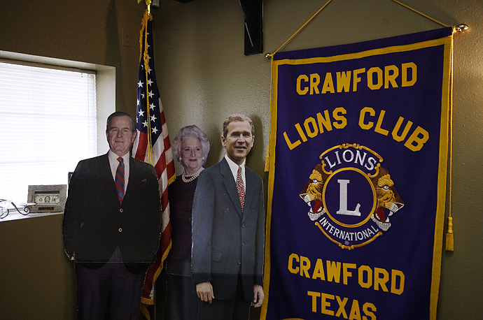 Cardboard cut-outs of Presidents George H.W. Bush, George W. Bush and Barbara Bush stand at the Coffee Station in Crawford, Texas.