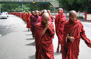 Thousands of Buddhist monks marching in defiance of Burma's oppressive military regime [Credit: TIME]
