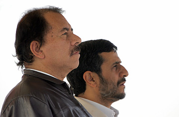 Iranian President Mahmoud Ahmadinejad (R) and his Nicaraguan counterpart Daniel Ortega (L) listen to their national anthems.