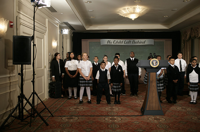 School children wait for President George W. Bush to arrive at a No Child Left Behind education event in New York, Wednesday, September 26, 2007.
