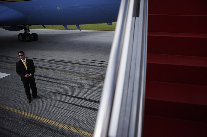 A Secret Service agent stands beneath Air Force One  in Lancatser, Pennsylvania.