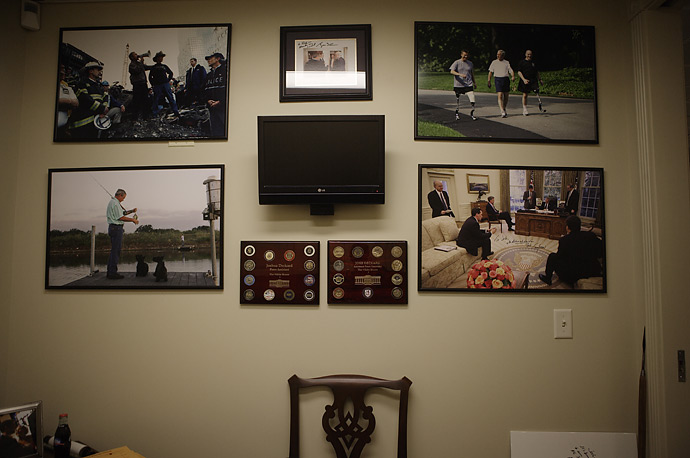 Photographs of the President adorn the wall of the lower press office in the West Wing of the White House.