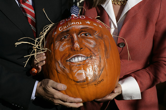 Republican presidential candidate former New York Mayor Rudy Giuliani and his wife Judith hold a pumpkin with his face painted on it at Lull Farm in Hollis, N.H., Sunday, Oct. 28, 2007.