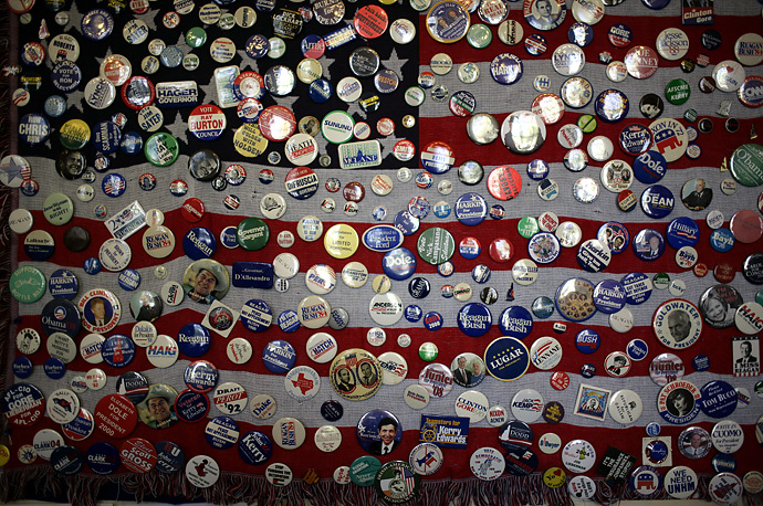 Buttons from campaigns past adorn a flag on the wall in the New Hampshire State House in Concord.