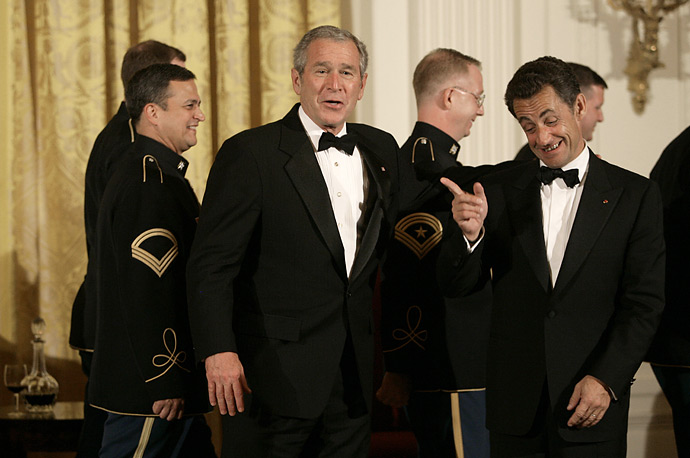 French President Nicolas Sarkozy, right, talks with U.S. President George W. Bush during the entertainment portion of a social dinner at the White House