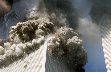 The south tower of New York's World Trade Center, left, begins to collapse after a terrorist attack on the buildings as shown in this Sept. 11, 2001, file photo.