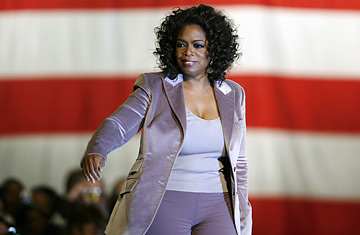 Oprah Winfrey walks on stage before speaking at a rally for Democratic presidential hopeful, Sen. Barack Obama, D-Ill., Saturday, Dec. 8, 2007, in Des Moines, Iowa.