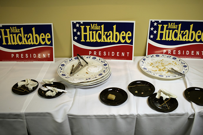 Dirty dishes litter a table at a campaign event for Republican presidential candidate Mike Huckabee at a Chinese restaurant in Bow, New Hampshire.