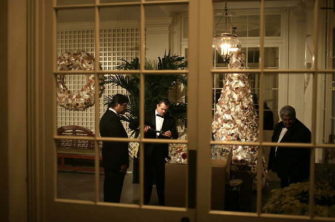 White House butlers prepare drinks at a staging area for a holiday party. In December President Bush and first lady Laura Bush host 25 holiday parties at the White House, entertaining over 12,000 guests.