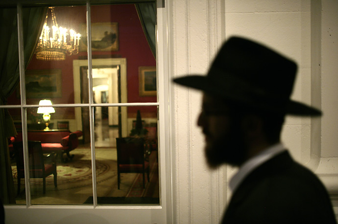A jewish journalist walks past the Red Room before attending the Hanukkah Reception at the White House.