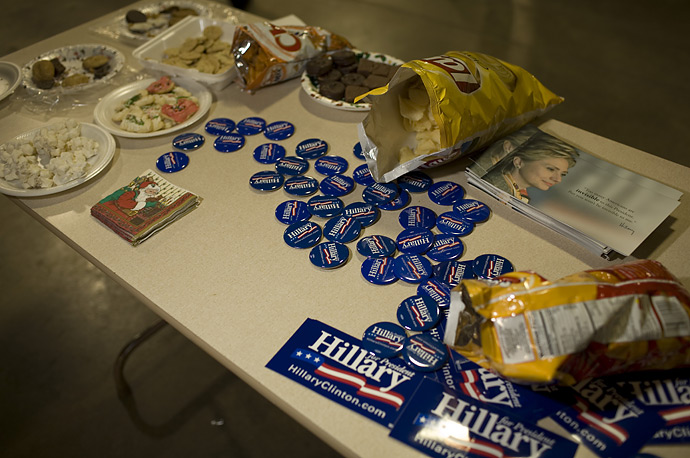 Campaign buttons, stickers and literature share a table with snack food at a Hillary Clinton event on the Jackson County Fairgrounds in Maquoketa, Iowa