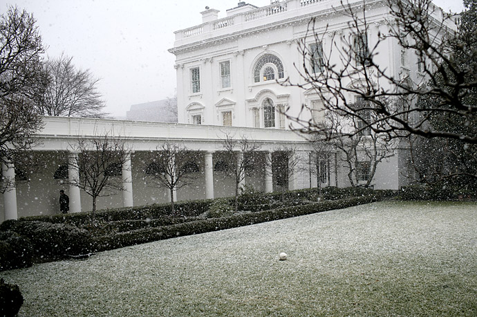 Snow falls in the Rose Garden at the White House in Washington.