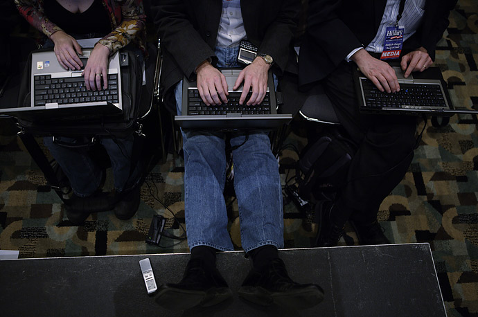 Reporters hammer away on their laptops during a Hillary Clinton campaign stop in Council Bluffs, Iowa. .