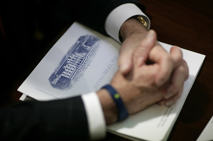 Participants at a presidential meeting with U.S. mayors were given White House briefing booklets.