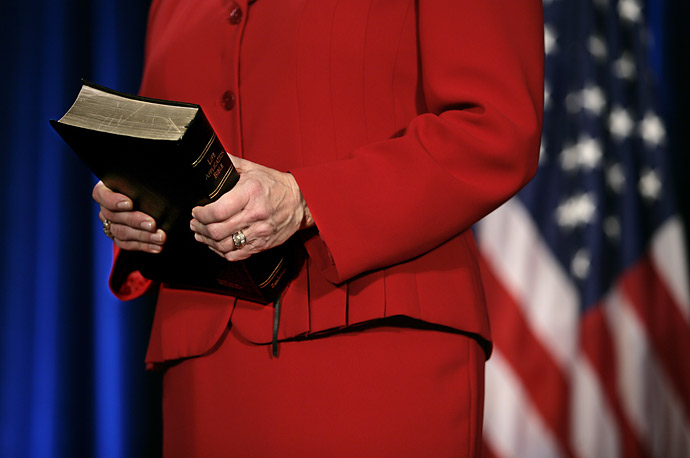 Nancy Schafer holds the Bible at the ceremonial swearing-in of her husband Ed to be the new Agriculture Secretary in  for President Bush.