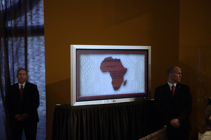 A multimedia presentation plays on a screen at the Smithsonian National Museum of African Art, where President spoke on February 14.
