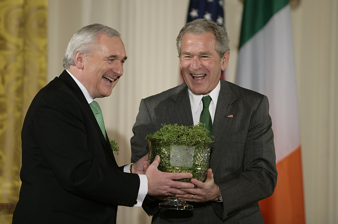 President George W. Bush and Irish Prime Minister Bertie Ahern share a laugh as they take part in a St. Patrick's Day reception,