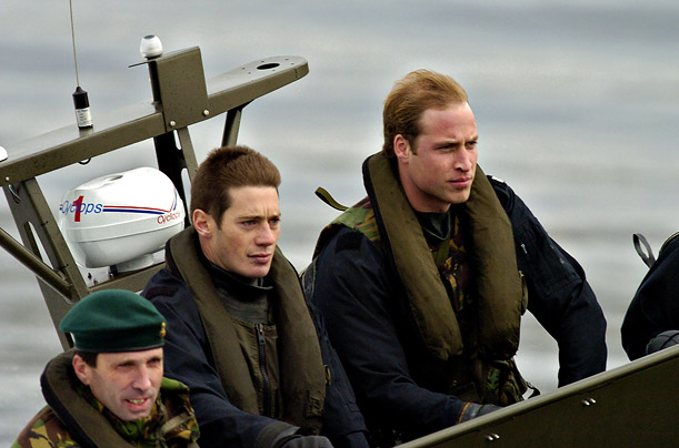The Prince with Royal Marines on a tour of a Naval Base in Scotland