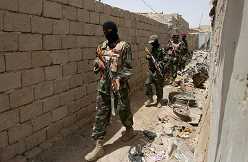 Iraqi soldiers check a house during a military operation in the holy city of Karbala, southern Iraq, April, 2008.