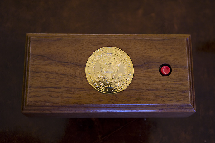 A call button for President Bush on his desk in the Oval Office.