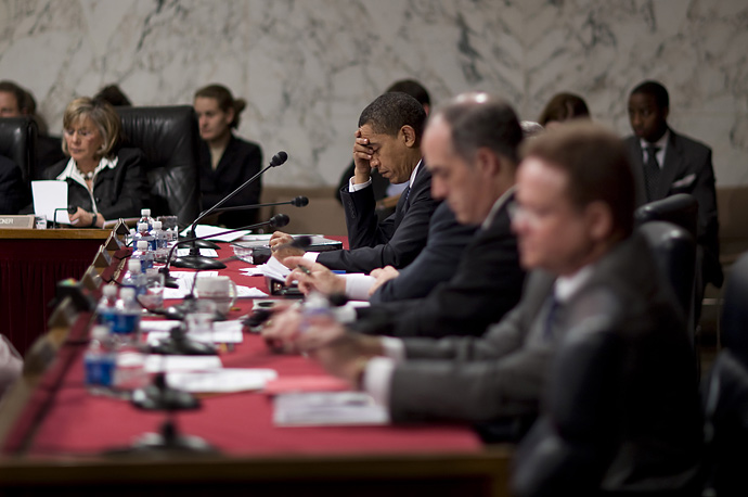 Sen. Barack Obama listens to testimony from General David Petraeus and Ambassador to Iraq Ryan Crocker to the Senate Foreign Relations Committee on Capitol Hill in Washington, April 8, 2008.