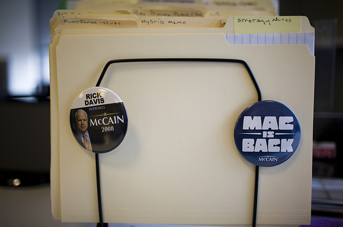 File folders and campaign buttons on the desk of Republican Presidential candidate John McCain's Campaign Manager Rick Davis, at the campaign's headquarters in Arlington, Virginia.