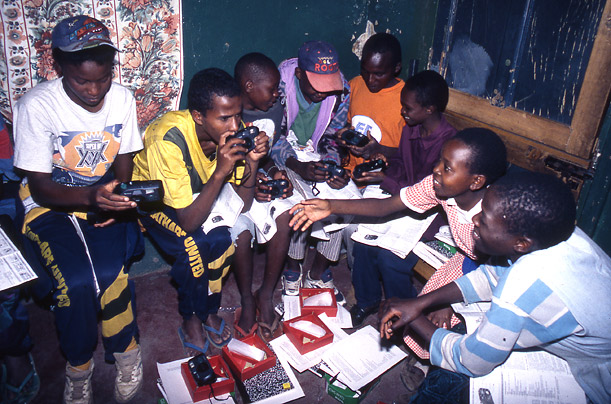 The Shootback group on the first day of the project in August 1997, holding their new cameras for the first time