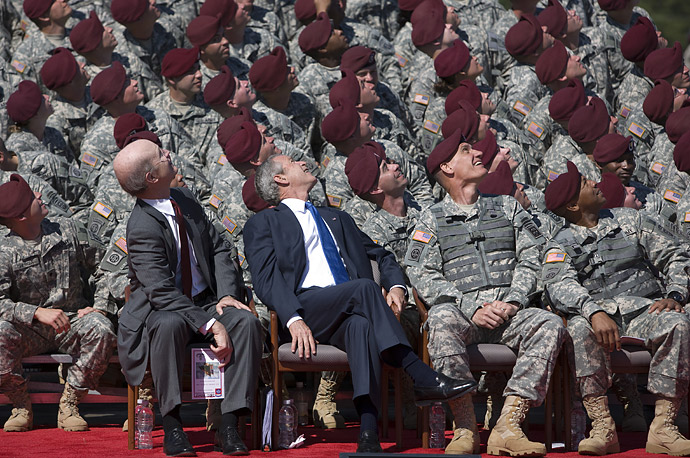 President George W Bush watches members of the Army's 82nd Airborne Division parachute onto the field during a division review ceremony, Thursday, May 22, 2008, at Fort Bragg, N.C.