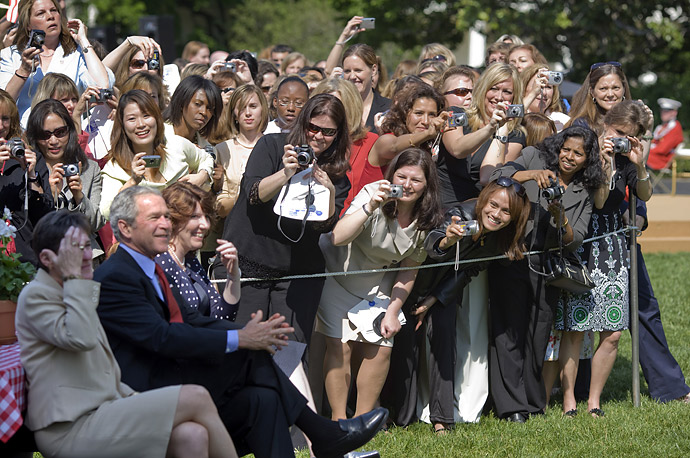 Guests at Military Spouse Day, held on the South Lawn of the White House, take President Bush's photo.