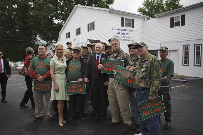 John and Cindy McCain pose for a picture with supporters at the St. Albans Gun and Archery in Charleston, West Virginia.