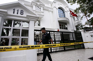 A Malaysian police officer walks in front of the Turkish Embassy in Kuala Lumpur on June 29