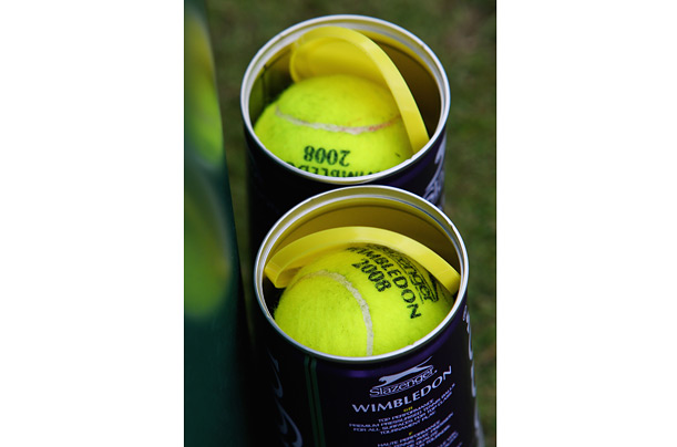 Tubes of new balls are open and ready for play